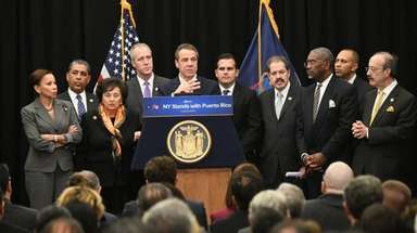 Gov. Andrew Cuomo at a briefing with Gov.