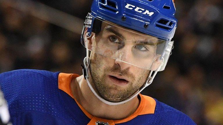 Islanders center John Tavares looks on against the