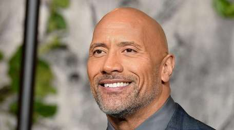 Dwayne Johnson attends the premiere of Jumanji: Welcome