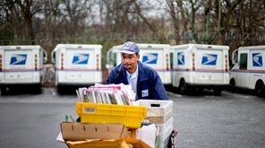A U.S. Postal Service letter carrier gathers mail
