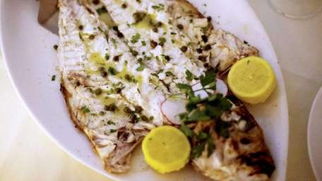 Whole grilled fagri, a Greek snapper, is served