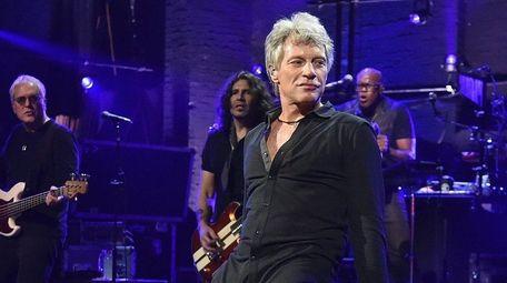 Jon Bon Jovi performing at the Barrymore Theatre