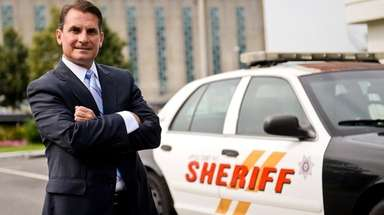 Suffolk Sheriff Vincent DeMarco stands in front of