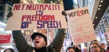 Demonstrators rally in support of net neutrality earlier