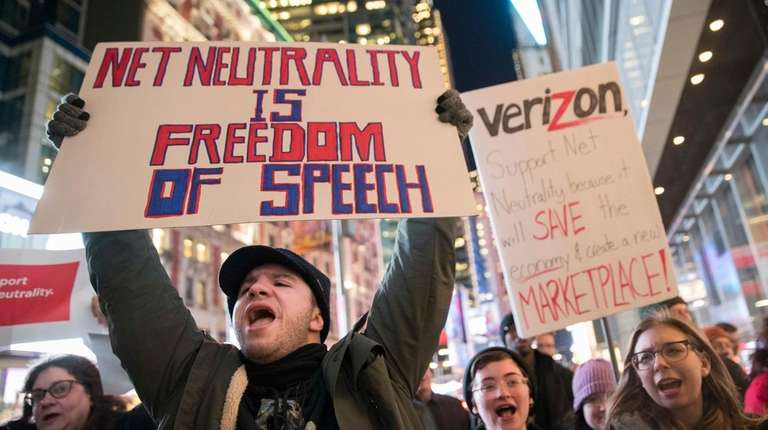 Demonstrators rally in support of net neutrality earlier
