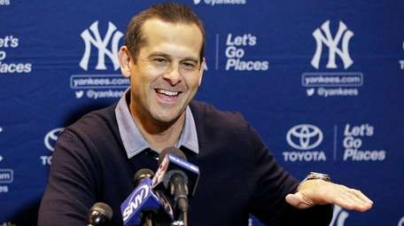 Yankees manager Aaron Boone talks with the media