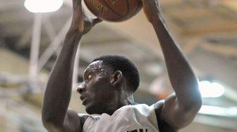 Isaiah Bien-Aise of Westbury pulls down a rebound
