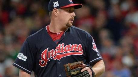 Indians relief pitcher Bryan Shaw pauses between pitches