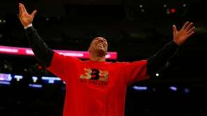 LaVar Ball reacts after a basket by his