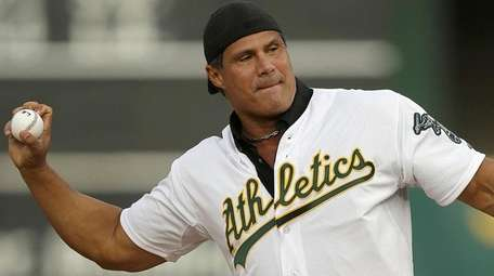 Former Oakland Athletics player Jose Canseco throws out