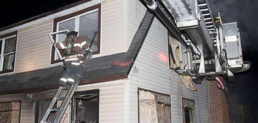 Firefighters extinguish a blaze on Grove Street in