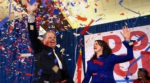Democrat Doug Jones and his wife, Louise, wave