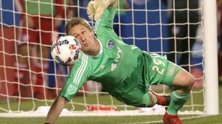 Sporting Kansas City goalkeeper Tim Melia defends during