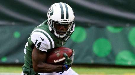 Jets wide receiver Jeremy Kerley tries to avoid