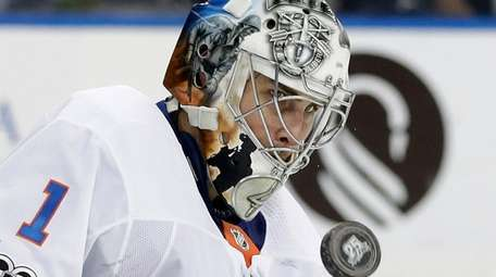 Islanders goalie Thomas Greiss makes a save on