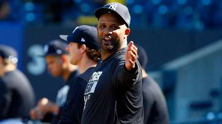 Yankees pitcher CC Sabathia gestures during work out