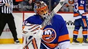Jaroslav Halak of the Islanders reacts after allowing