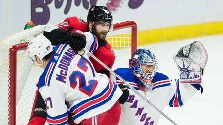 Rangers defenseman Ryan McDonagh pushes Senators left wing