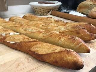 Baguettes are among the artisanal breads baked at