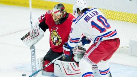Rangers left wing J.T. Miller tries to tip