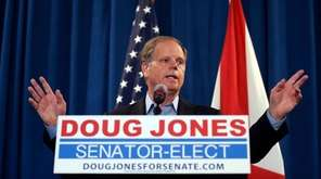 Sen.-elect Doug Jones speaks during a news conference