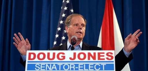 Sen.-elect Doug Jones speaks during a news conference