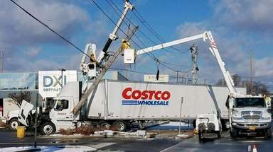 A Costco tractor trailer after hitting a utility