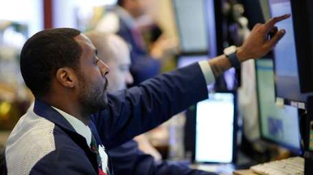 Stock trader Aaron Ford works at the New