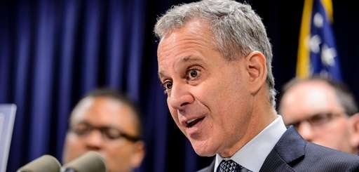 Eric Schneiderman speaks at a press conference in
