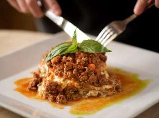 Rich, savory and meaty lasagna Bolognese served at