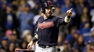 Jason Kipnis of the Indians celebrates after scoring