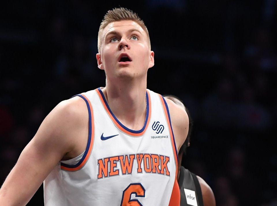 Knicks forward Kristaps Porzingis looks for a rebound