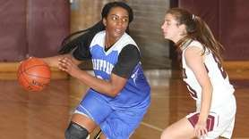 Hauppauge's Christina John (33) moves the ball around