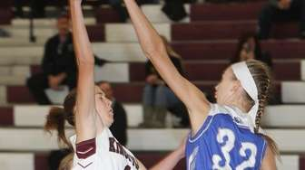 Kings Park's Haley Jette (1) puts one up