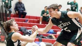 Locust Valley's Frank Smith lends a hand to