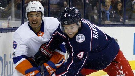 The Islanders' Joshua Ho-Sang, left, and the Blue