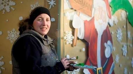 MW Designs owner Marianne Wegener paints a holiday-themed
