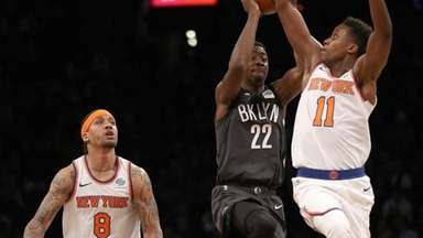 Caris LeVert of the Nets takes a shot