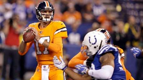 Broncos quarterback Brock Osweiler throws against the Colts