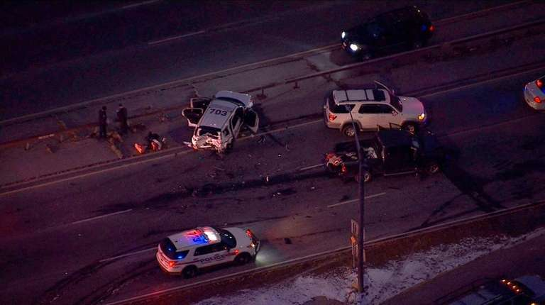 A two-vehicle crash involving a police vehicle forced