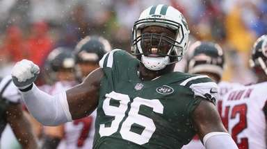 Jets defensive end Muhammad Wilkerson celebrates a tackle