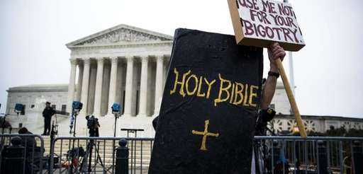 A protester dressed as the Bible rallies earlier