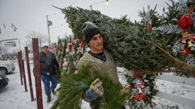 Anthony Aiello of Lindenhurst gets ready for Christmas