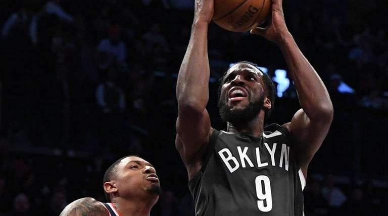 Nets forward DeMarre Carroll puts up a shot