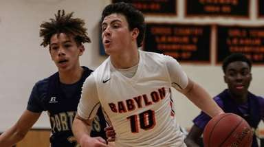 Babylon's Joseph Rende goes around Greenport's Jaxan Swann
