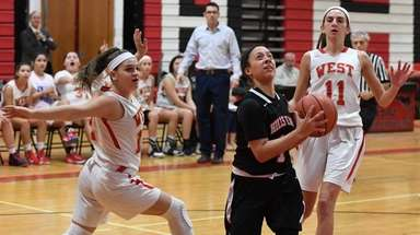 Half Hollow Hills East guard Jessica Womble drives