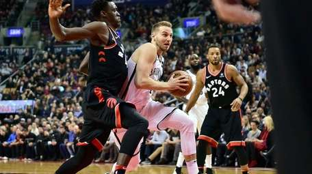 Nets guard Nik Stauskas drives to the net