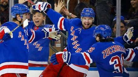 The Rangers' Rick Nash celebrates his third-period goal