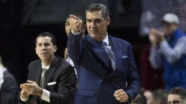 Villanova coach Jay Wright points after a made