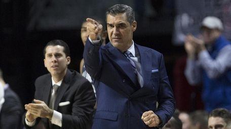 Villanova coach Jay Wright points after a made